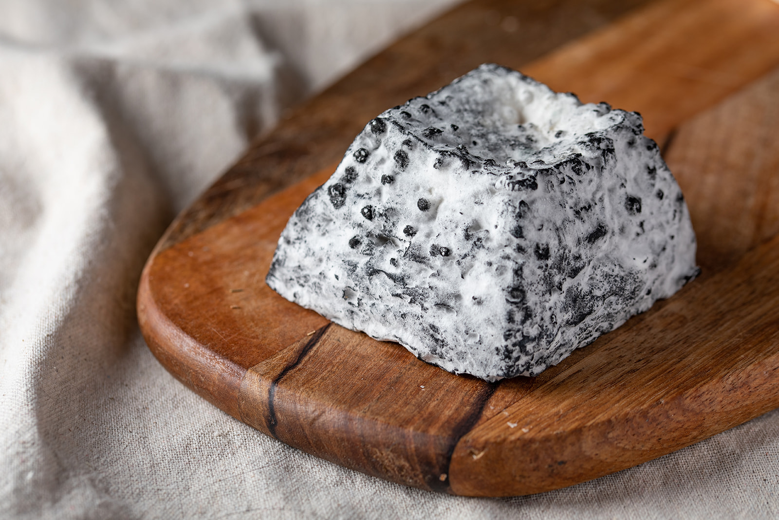 Ash-Pyramid Goat Cheese coated with Chestnut ash and white mold